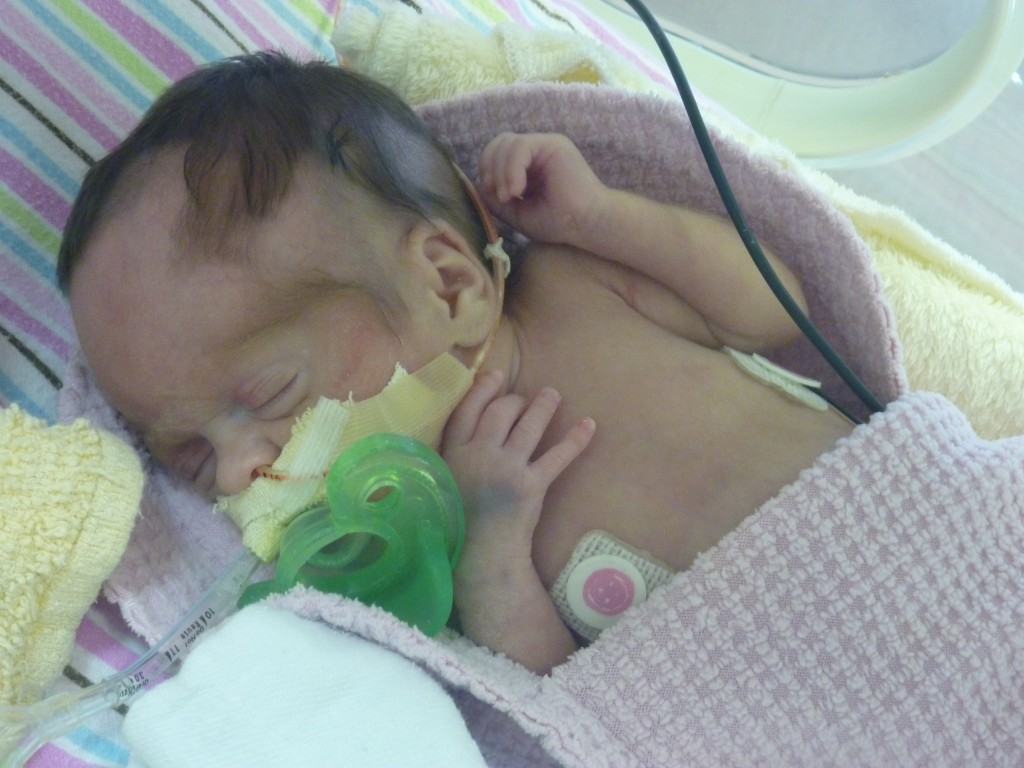 The tiny preemie soother was still too big for our tiny but mighty princess. But it helped teach her how to suction.